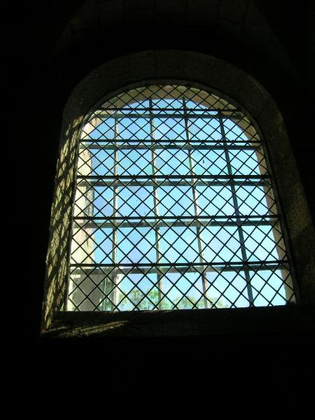 Glass windows began appearing in castles in the late 12th century. This window is from the Cloisters Museum in New York